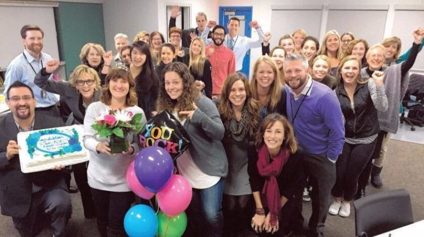 Dinah Brown, front and center in crown, celebrates with Del Mar Union School District staff.