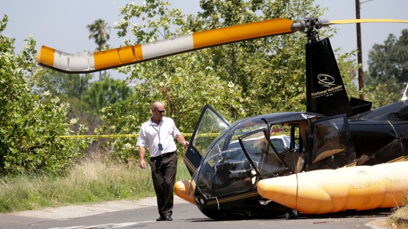 SHERIDAN OAKS CA JULY 21, 2017 -- An FAA investigator at the scene of a helicopter that crash-lande