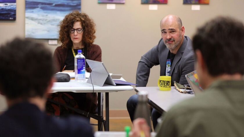 "Actor/playwright Lance Arthur Smith listens during an actors read-through of his latest project, ""The Price of Peace,"" in The Foundry Artist Studios that are adjacent to the New Village Arts Theatre. At left is the play's director Lisa Berger."