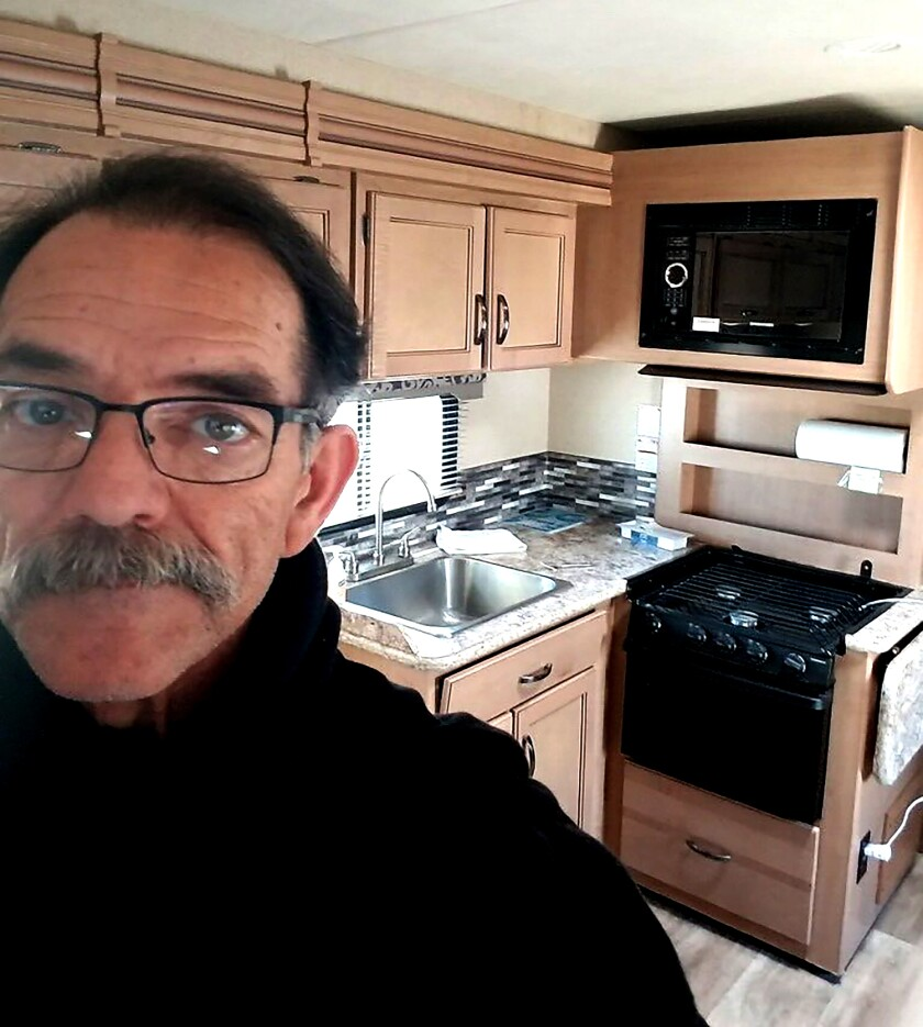 Reggie Dominguez in a trailer at Dockweiler Beach RV Park, where he's quarantining with what might be COVID-19.