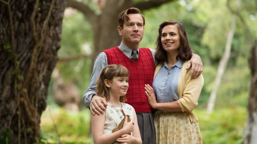 (L-R) - Bronte Carmichael plays Madeline Robin, Ewan McGregor plays her father Christopher Robin and