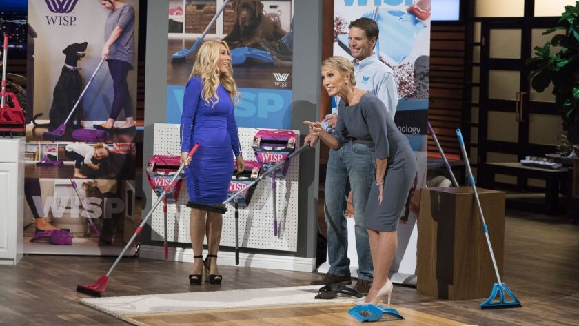 "Wisp Industries CEO Eben Dobson, of Solana Beach, shared his re-invented dustpan and broom with judges Lori Greiner, left, and Barbara Corcoran on an episode of ABC's ""Shark Tank"" that aired Nov. 18."