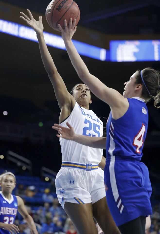 American guard Emily Kinneston (4) goes to the basket against UCLA forward Monique Billings (25) in the first half Saturday at Pauley Pavilion.