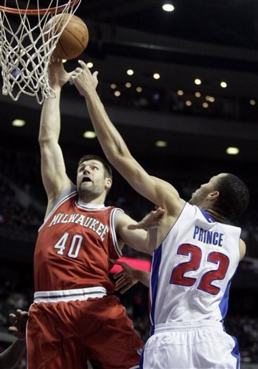 Milwaukee Bucks' Jon Brockman (40) takes a shot against Detroit Pistons' Tayshaun Prince (22) in the first half of an NBA basketball game Friday, April 8, 2011, in Auburn Hills, Mich. (AP Photo/Duane Burleson)