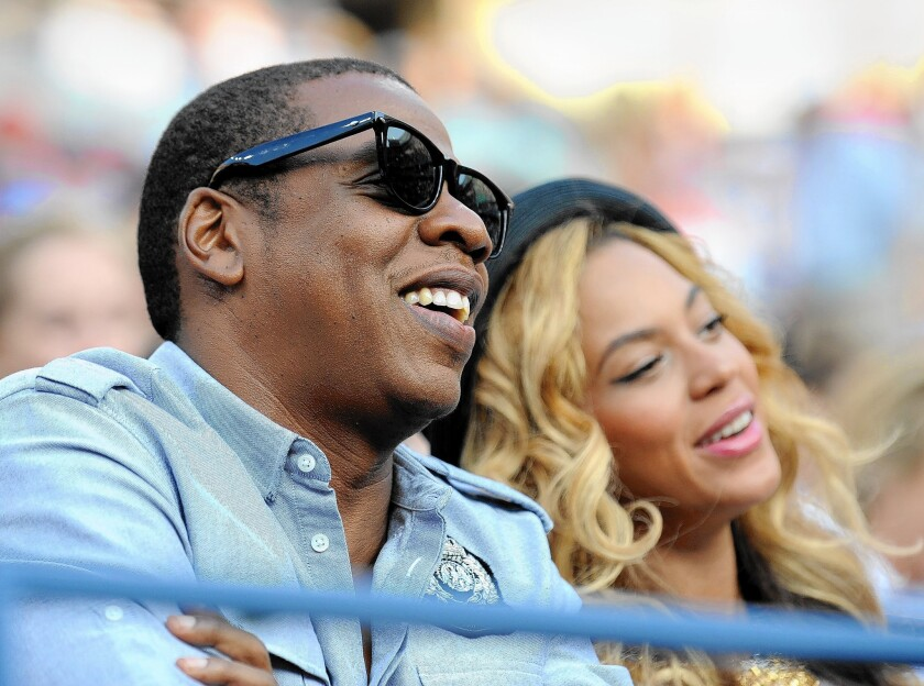 A video containing footage of Jay-Z used to support Proposition 47 is the subject of a campaign penalty. The entertainment mogul is seen here with his wife, Beyoncé.