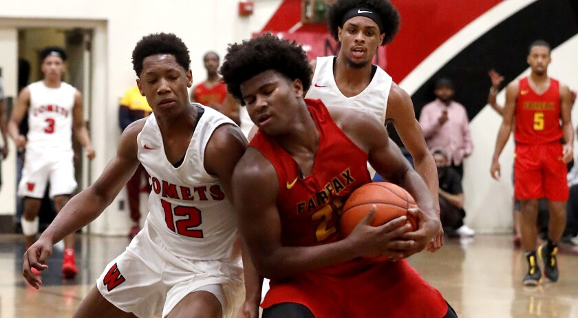 LOS ANGELES, CALIF. - JAN. 25, 2019. Westchester guard Kevin Bethel tries to swat the ball away from