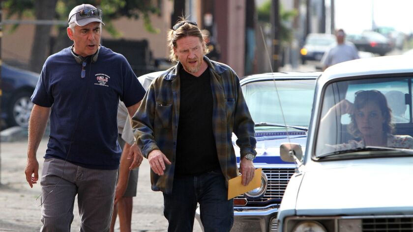 "Adam Arkin (left), a director for the new cable drama ""Terriers,"" speaks with actor Donal Logue as t"