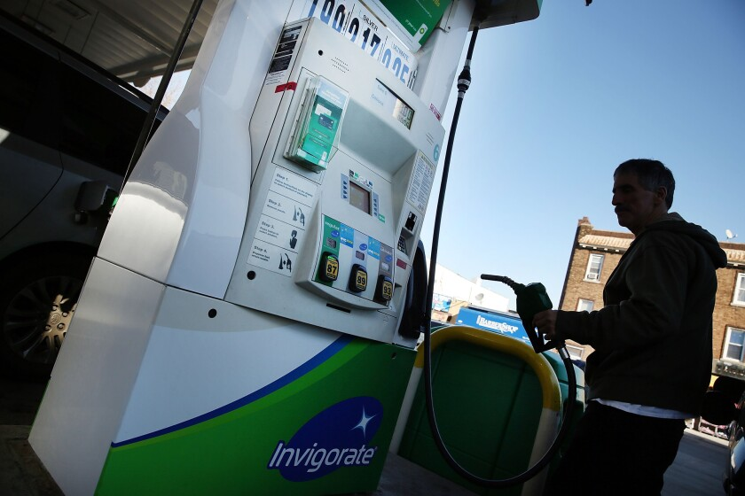 A customer fills up his car at a BP gas station in Brooklyn, N.Y., on Feb. 2.