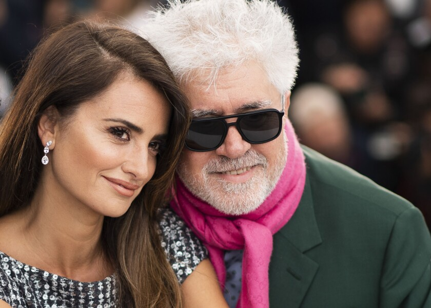 """FILE - Actress Penelope Cruz, left, and director Pedro Almodovar pose for photographers at the photo call for the film """"Pain and Glory"""" at the 72nd international film festival, Cannes, southern France, on May 18, 2019. The Venice Film Festival is kicking off its 78th edition on Sept. 1, 2021, on the Lido with the premiere of Almodóvar's """"Madres Paralelas,"""" starring Cruz. (Photo by Arthur Mola/Invision/AP, File)"""