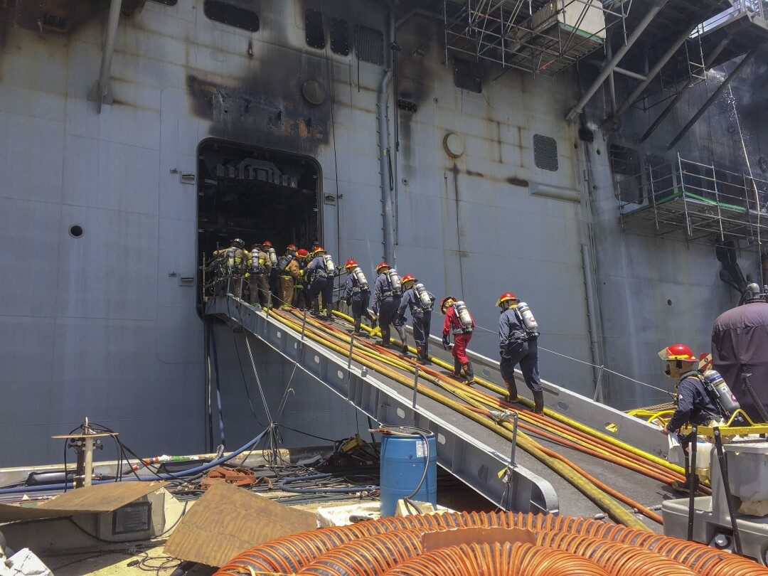 Sailors combat a fire aboard the amphibious assault ship USS Bonhomme Richard on July 13, 2020.