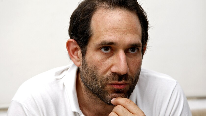In a lawsuit filed Wednesday, American Apparel founder Dov Charney said members of the company's board of directors, along with hedge fund Standard General, conspired to push him out of the company.