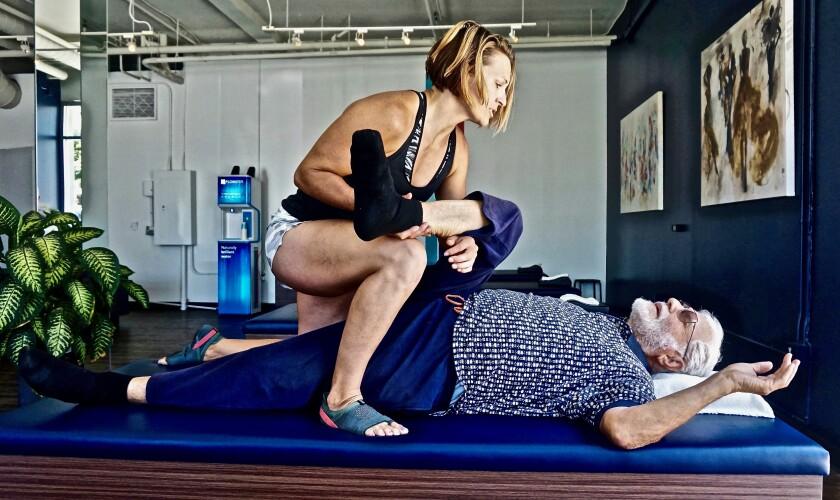 Flexologist Karyl Sands at work at StretchLab.