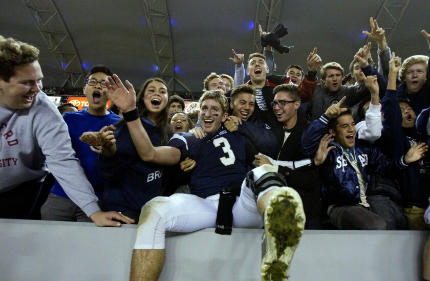 St. John Bosco quarterback Josh Rosen celebrates with students and fans following the Braves' 20-14 victory over Concord De La Salle in the CIF state championship Open Division bowl game.