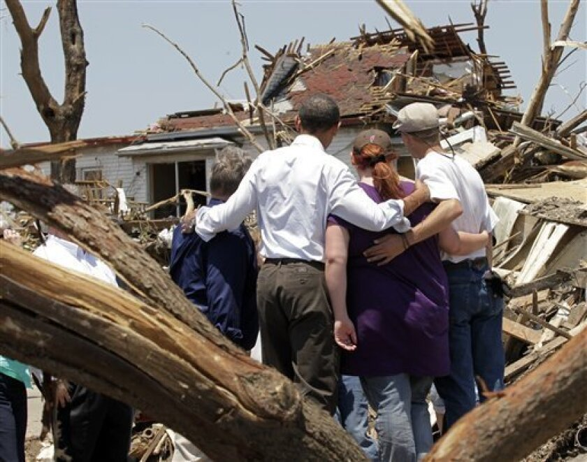 FILE - This May 29, 2011 file photo shows President Barack Obama, second from left, with residents viewing damage from the tornado that devastated Joplin, Mo. A month packed with tornadoes and flooding has caused billions of dollars of damage in Missouri. And the economic aftershocks may be felt for years. (AP Photo/J. Scott Applewhite)
