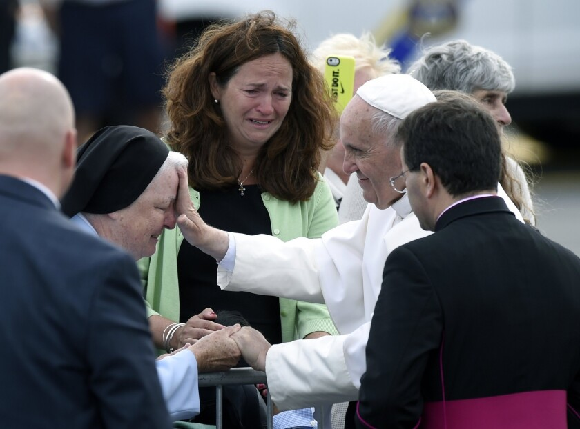 Pope Francis stops to meet people after arriving at Philadelphia International Airport.