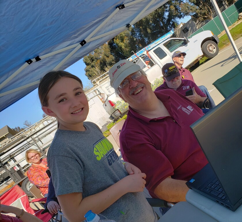 Third-grader Joe Attilli with ROARS member Andrew Lenci, learning how to communicate via amateur radio.