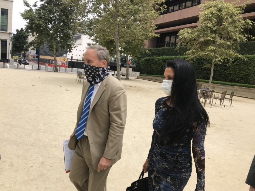 Gina Champion-Cain, leaving federal court last year.
