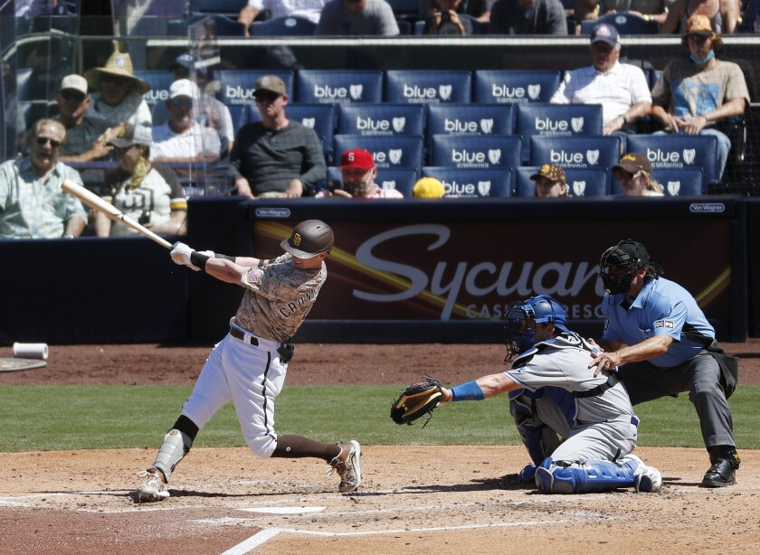 Padres' Jake Cronenworth hits a home run in the 4th inning against the Los Angeles Dodgers at Petco Park on April 18.