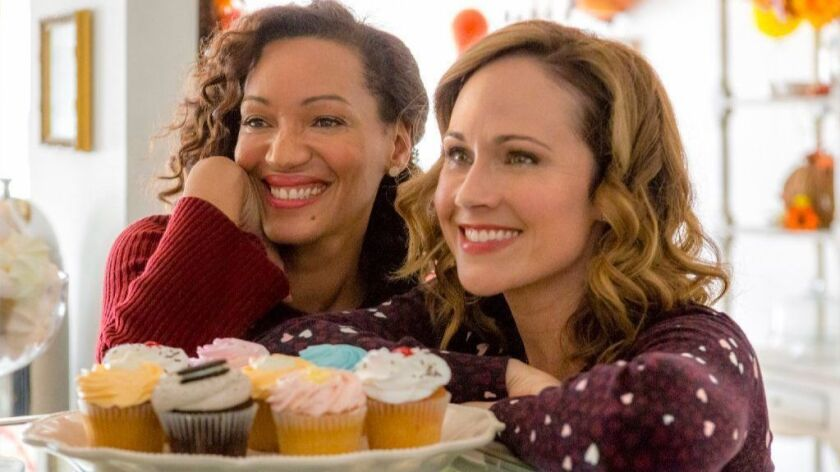 """Karen Holness, left, and Nikki DeLoach in the TV movie """"Truly, Madly, Sweetly"""" on Hallmark."""
