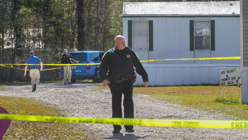 Investigators work the scene of a shooting in Livingston Parish in Louisiana. Authorities in Louisi