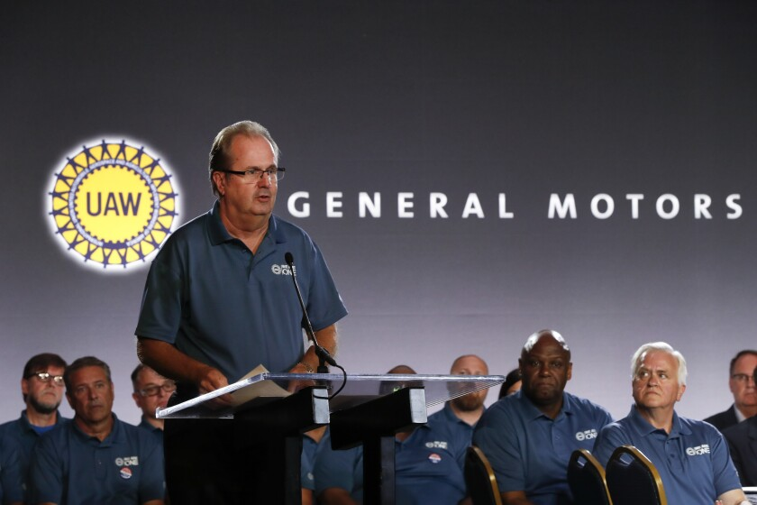 United Auto Workers President Gary Jones, shown speaking during the opening of contract talks with General Motors, stepped aside Saturday amid a Justice Department probe.