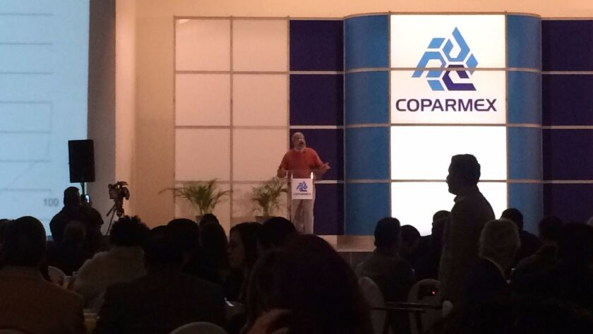 "Economist Maracino Schettino speaks at a monthly meeting of Coparmex, an association of business leaders, in Tijuana. He argued Americans who voted for the president did not vote for him because they felt ""left behind"" in the economy, but for social reasons."
