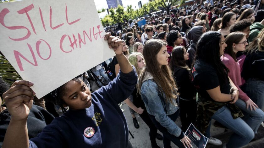 Hamilton High School student Aiyana Dab'riel holds a sign during a March 14 walkout in support of the shooting victims in Parkland, Fla. Students nationwide will rally again on Saturday.