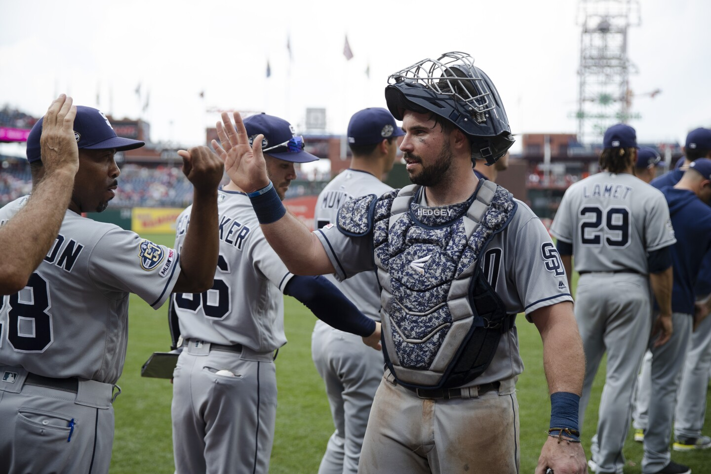 San Diego Padres' Austin Hedges, right, walks off the field after a baseball game against the Philadelphia Phillies, Sunday, Aug. 18, 2019, in Philadelphia. (AP Photo/Matt Rourke)