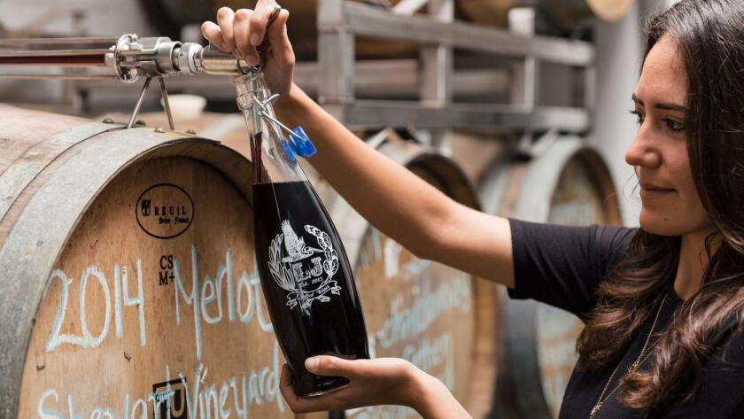 Wine on tap, straight from the barrel, is poured into growlers to take home at LJ Crafted Wines in Bird Rock. (Courtesy photo)