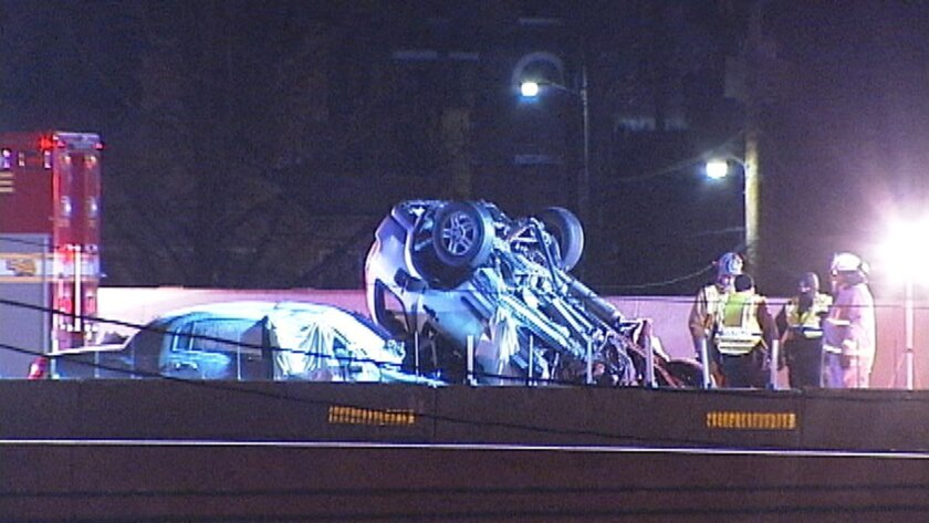 In this image made from video, emergency workers stand at the scene of a fatal collision on Interstate 75 in Dayton, Ohio, early Saturday, Feb. 13, 2016. A suspected drunken driver going the wrong way slammed head-on into an SUV, killing himself and four people inside the other vehicle, police said