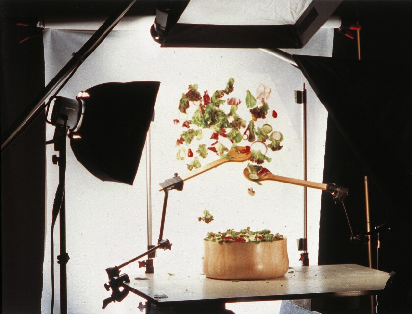 Photo shoot for tossing a salad.
