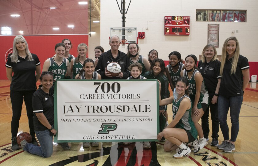Poway High coach Jay Trousdale, center, with the girls basketball team that cinched his 700th career victory on Saturday.