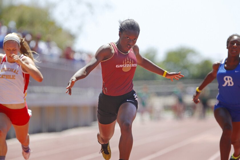Suzie Acolatse of Mission Hills wins the 100-meter race in a section meet record time of 11.59 seconds.