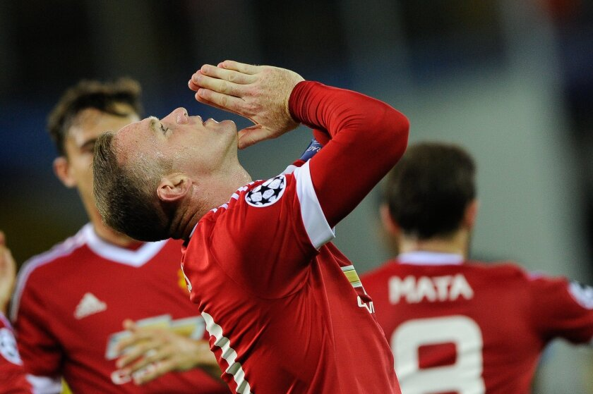 Manchester United's Wayne Rooney gestures after scoring a goal during the Champions League play-off round, second leg soccer match at the Jan Breydel Stadium in Brugge, Belgium on Wednesday Aug. 26, 2015. (AP Photo/Laurent Dubrule)