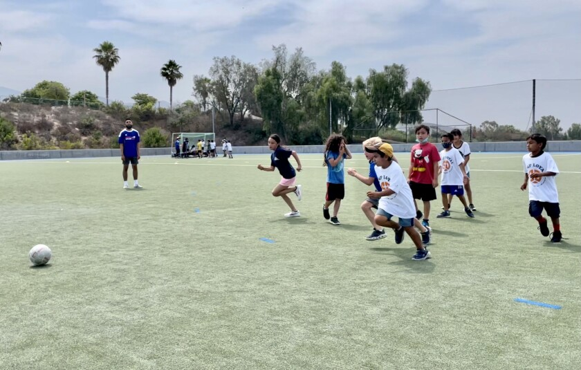 Children participate in a summer camp organized by the Chicano Federation and the San Diego Loyal team