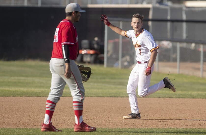 Estancia's Garrett Palme celebrates after his walk-off hit in the bottom of the eighth inning lifted the Eagles to a 1-0 win over Savanna in the first round of the CIF Southern Section Division 5 playoffs at home on May 2, 2019.