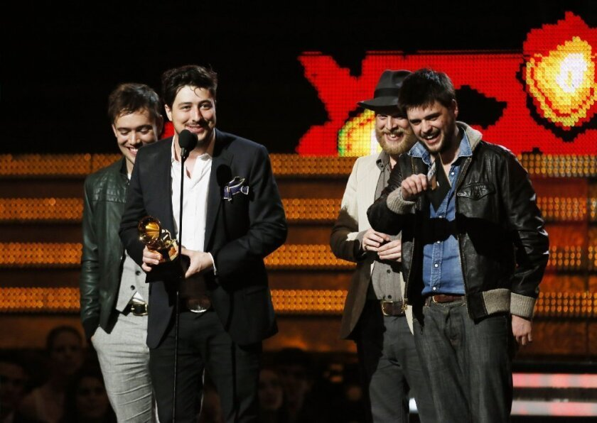 Mumford & Sons on stage at the 55th Annual Grammy Awards.