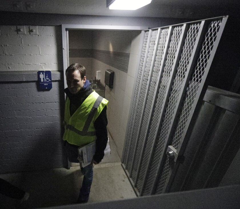 Josh Fryday comes up empty at a bathroom in Burbank's Brace Canyon Park as he searched for people to document on Tuesday, Jan. 22, for the Greater Los Angeles Homeless Count.