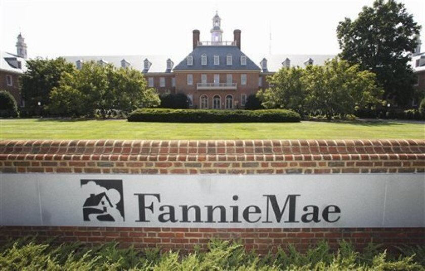 FILE - In this Aug. 8, 2011, photo, the Fannie Mae headquarters is seen in Washington. Fannie Mae reports its earnings for the January-March quarter on Thursday Aug. 8, 2013. (AP Photo/Manuel Balce Ceneta, File)