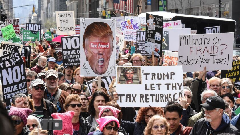 People participate in a Tax Day protest on April 15, 2017, in New York City.