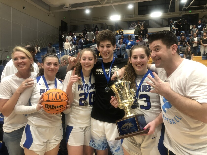 The Arnold family won four championship rings playing for Palisades on Saturday. Mother Stacey (left) celebrates championships for children Sammie, Elise, Caden and Taylor along with husband Michael.
