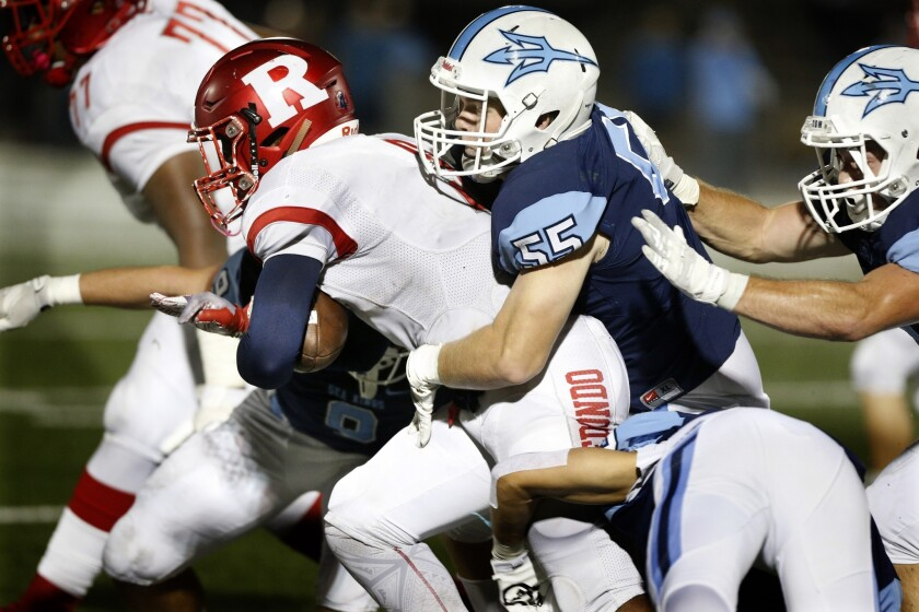 Corona del Mar High defensive lineman Ethan Jajonie (55) moves in for a tackle in the first round of the CIF Southern Section Division 4 playoffs against Redondo Union at Davidson Field on Nov. 2, 2018.