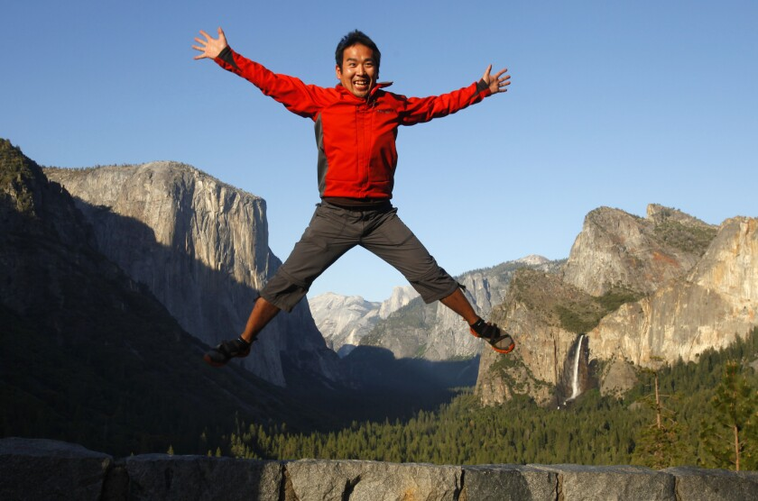 Making his first visit to Yosemite National Park, Kinihiko Kosuge of Georgia jumps in the air for a photo at Yosemite Valley's Tunnel View viewpoint on May 18, 2013.