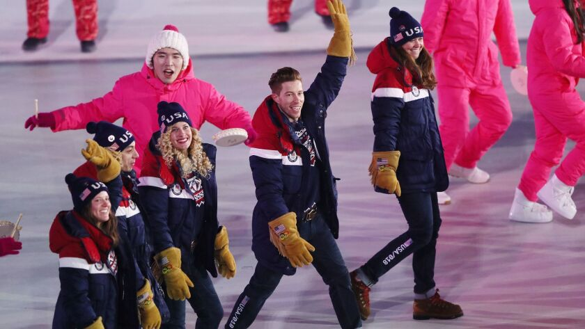 Shaun White waves during the opening ceremony of the Pyeongchang Winter Olympics.