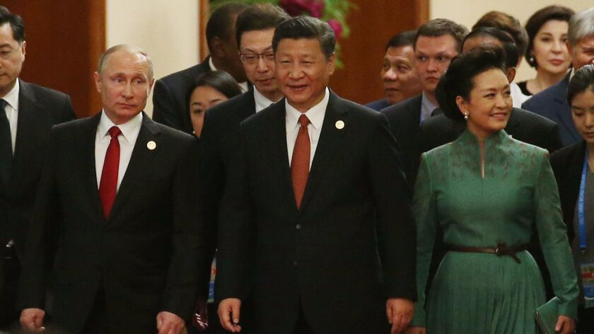 Chinese President Xi Jinping, center, and his wife, Peng Liyuan; Russian President Vladimir Putin, l