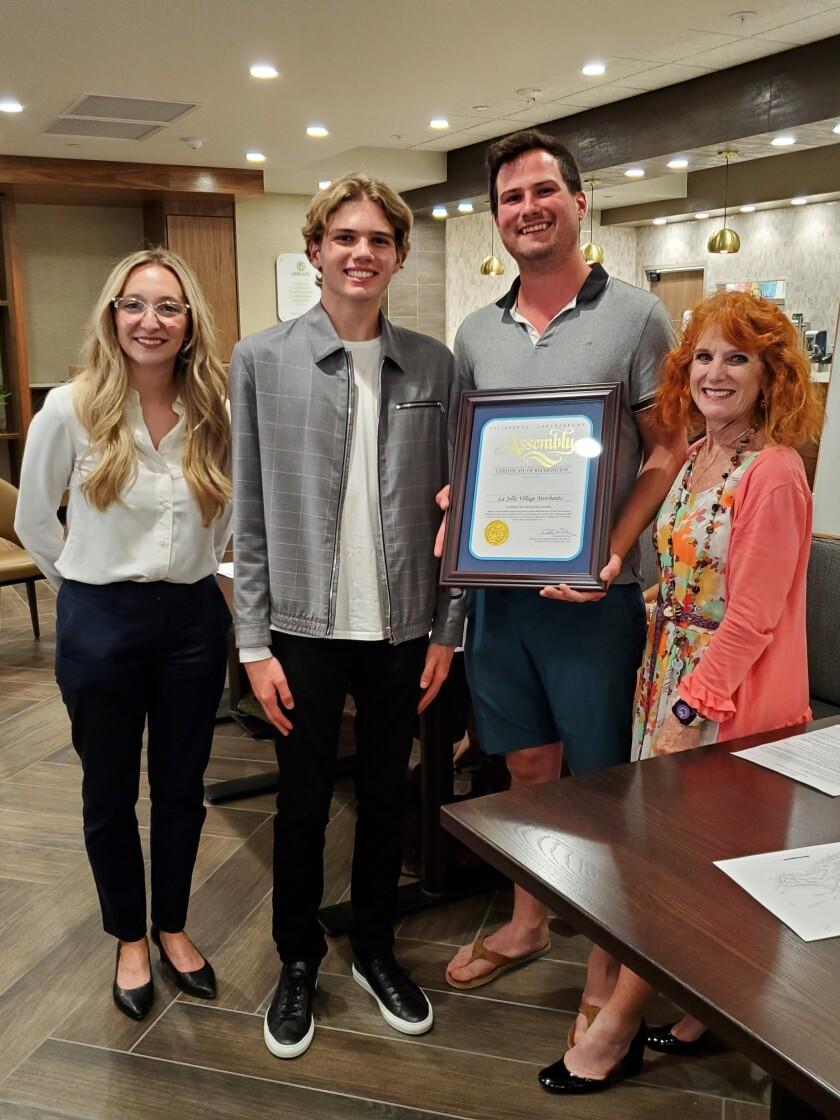 Rachel Granadino, Luca Bonnanon, Cody Decker and Jodi Rudick with a commendation from Assemblyman Chris Ward's office