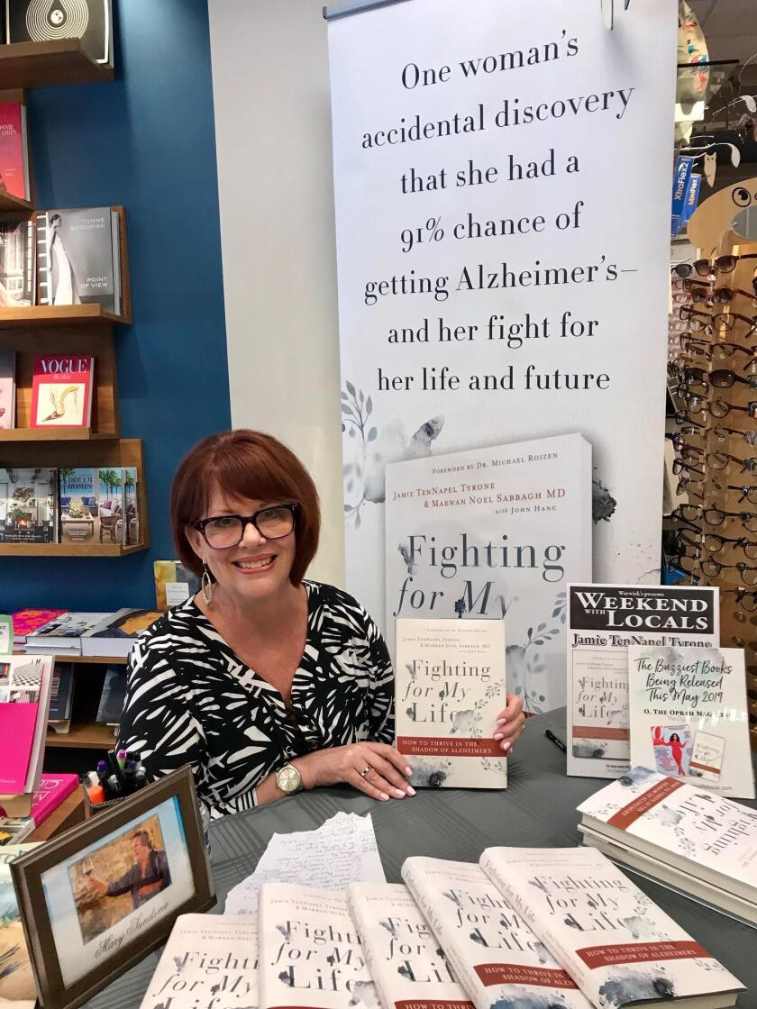 Jamie Tyrone holds a book signing at Warwick's bookstore in La Jolla on July 14, 2019.