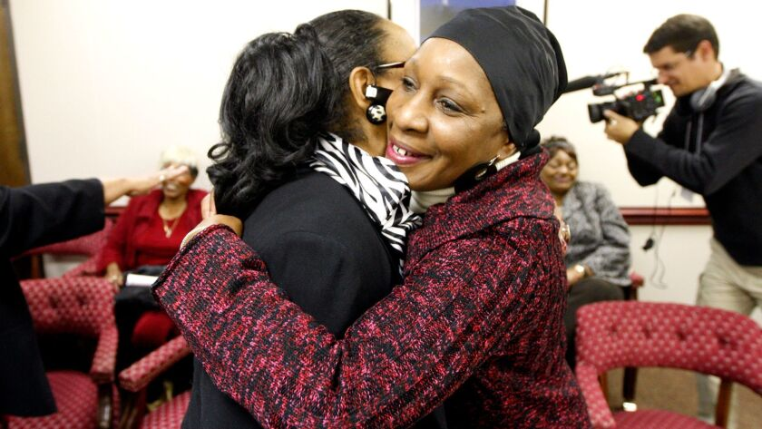 Women embrace in Raleigh, North Carolina on Jan. 10, 2012, after the Eugenics Compensation Task Force announced its recommendation that $50,000 be paid to each survivor who was sterilized under the state's eugenics program.