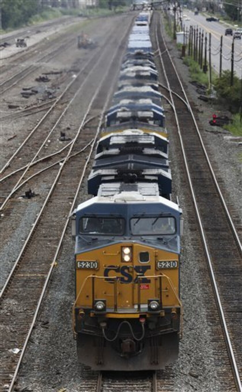 A CSX train rolls into Buffalo, N.Y., Monday, July 13, 2009. CSX is expected to release quarterly earnings after market close Monday. (AP Photo/David Duprey)