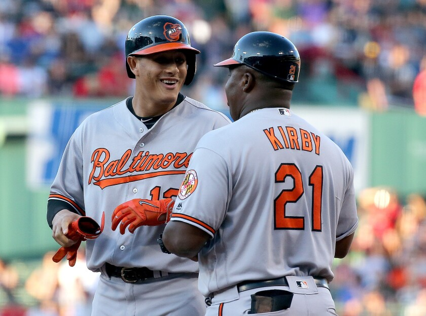 Manny Machado talks with first base coach Wayne Kirby when during a game when both were with the Orioles.